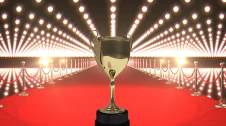 Digital composite of winning Golden Trophy on red carpet against glowing technlogy animated background
