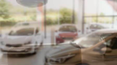 cserepezés : Digital composite of car dealership against falling animated gavel on the background Stock mozgókép