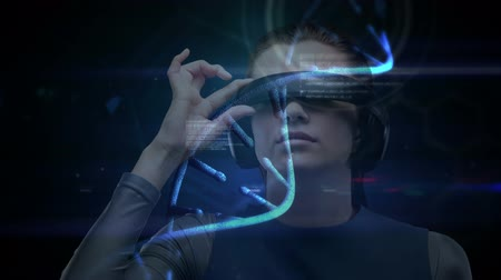 hieróglifo : Businesswoman using VR against digital animated DNA identification background Stock Footage