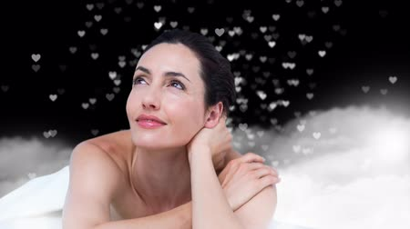 ás : Digital composite of woman smiling, with hearts raining down in background Stock Footage