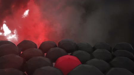 yağmur yağıyor : Digital composite of black and red Umbrellas with digital lightning against dag sky in the background