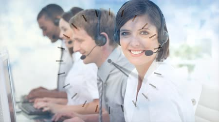 temsilci : Happy Customer Service colleagues using Headset against clock background Stok Video