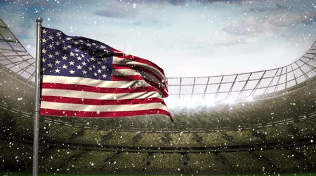 american football player : Animated american flag blowing in the wind against animated football stadium background with snow