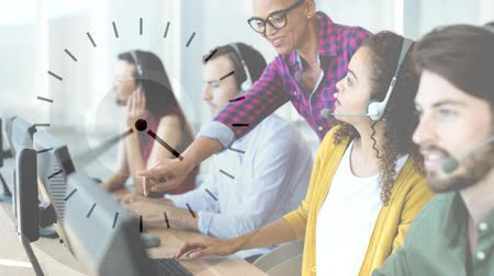 сотрудники : Happy Customer Service colleagues using Headset against clock background Стоковые видеозаписи