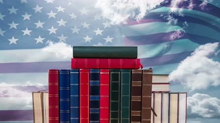 scholarship : Animated Books against american flag waving in the wind in the sky background