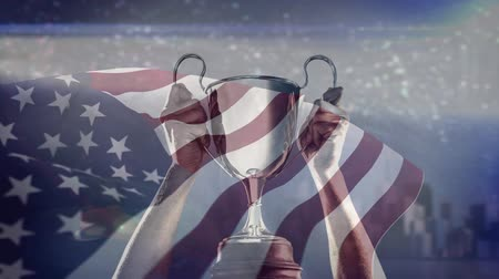 medal : Champions hands holding Trophy against american flag background and fireworks