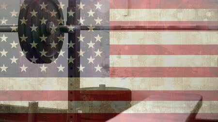 ferrugem : Weight bench and curl bar against animated american flag background Stock Footage