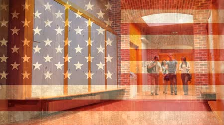 high school : College students walking through hallway after class against american flag background Stock Footage