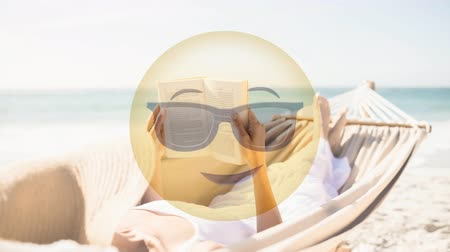 гамак : Animated Yellow Emoticon with sunglasses against woman laying in hammock background Стоковые видеозаписи