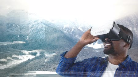 graphic arts : Businessman using VR against blue animated snowy nature background Stock Footage