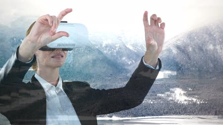 graphic arts : Businesswoman using VR against animated snow nature backrgound