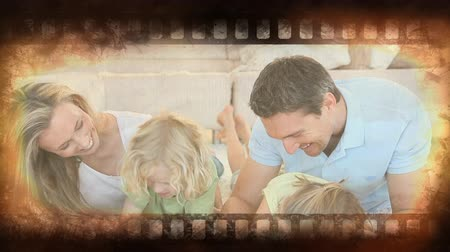 film leader : Old Movie tape showing happy family with children laughing