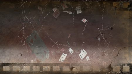slate : Old movie tape of poker cards flying around