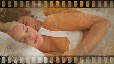 arduvaz : Old Movie tape showing happy cupple laying in bed