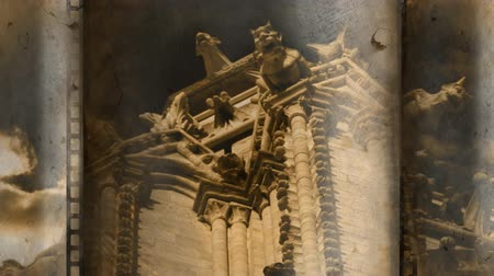 denominado retro : Old Movie tape showing old building gargoyles