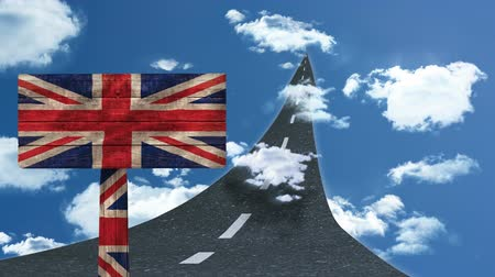 remote location : Animated street that leads into the sky with clouds against animated sign on britain flag Stock Footage