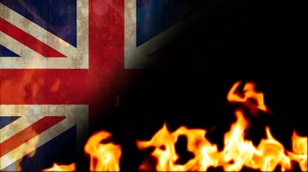politikacı : Burning fire flames against animated British flag background Stok Video