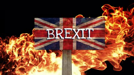 remote location : Burning fire flames against animated British flag background Stock Footage