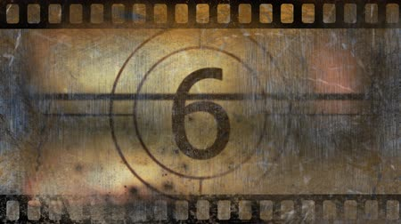 освещенный : Movie countdown black and white displaying numbers