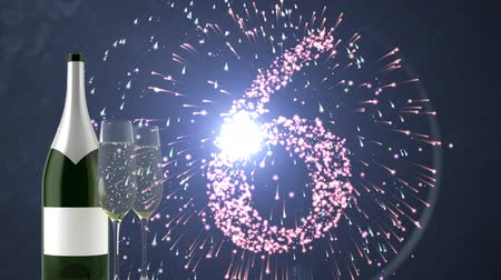 floodlight : Champagne bottle with glasses against animated firework countdown background Stock Footage