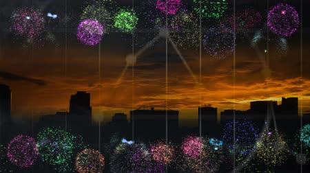 arranging : Animated fireworks against city skyline background
