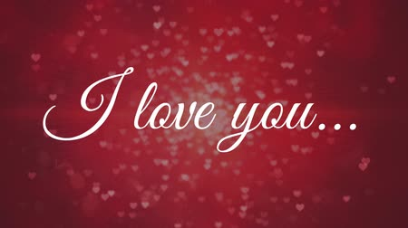 говорю : Digital composite of I love you against red background with floating hearts