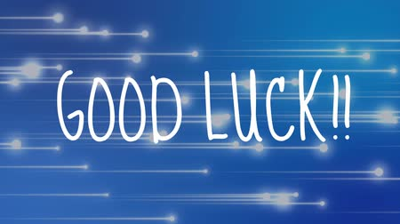 üdvözlettel : Digital composite of good luck wishes against blue background with moving lights Stock mozgókép
