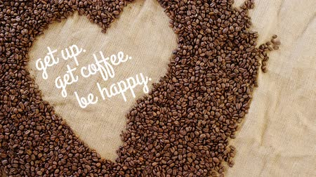cytat : get up get coffee be happy text handwritten, in a coffee bean made heart shape
