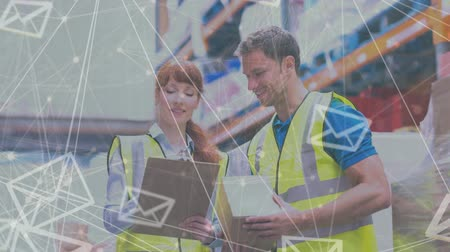 paket : Side view of warehouse manager and delivery man discussing plans in warehouse with animated email symbols in front
