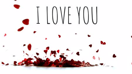 i love you : I love you message with some hearts thrown on a pile of little hearts that flies away