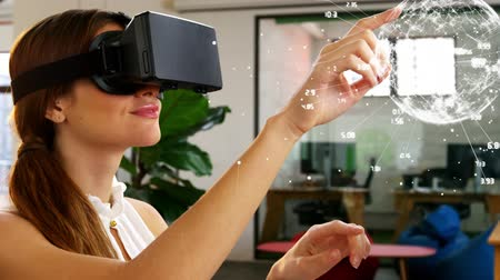 zkušenost : Digital composite of woman using virtual reality in office. Woman pointing at animated globe with connections.