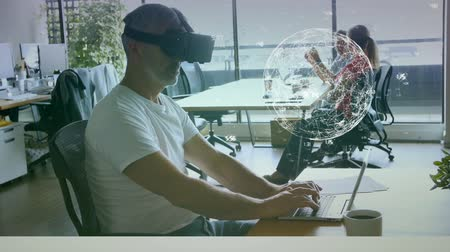 身なり : Side view of a man working on his laptop with a virtual reality glasses in an office