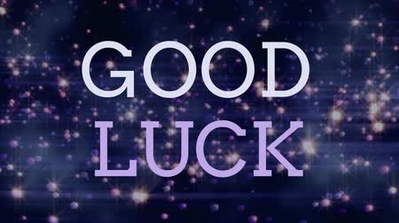 auguri : Good luck text on purple background with bright lights flying to the sky