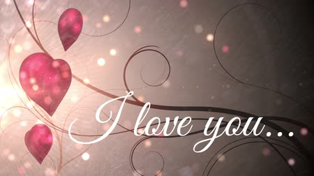 calligraphic : Slogan I love you with three hearts rotating, lots of light point flying everywhere and a calligraphic style background