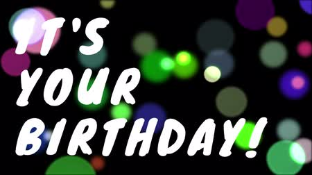 место : Slogan its your birthday in big letters on a dark background with lots of colors light moving