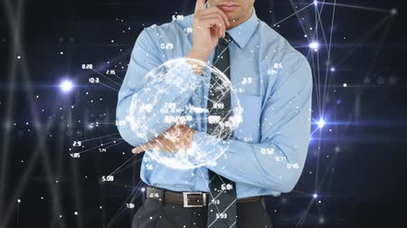 selecionando : Businessman looking at a digital earth with data on a dark background with connections and data moving Stock Footage