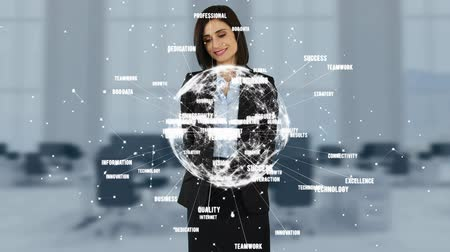 interaktif : Businesswoman smiling by looking at a digital earth with data on a blurred office background Stok Video