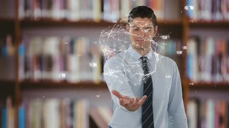 könyvesbolt : Front view of a businessmen holding an earth animation in his right hand against a library in the background