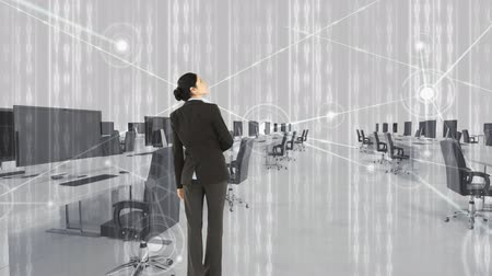 sofisticado : rear view of a businesswoman touching hologram screen in an office Stock Footage