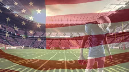 штаб квартира : Digital composite front view of american football player preparing to shoot ball with american flag in foreground Стоковые видеозаписи