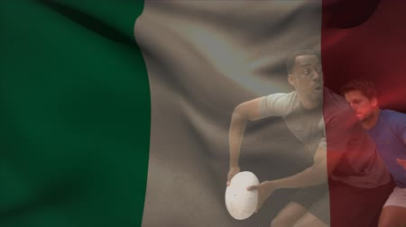 habilidade : Digital composite of african american rugby player throwing ball and getting tackled by opponent against Italian flag background Vídeos