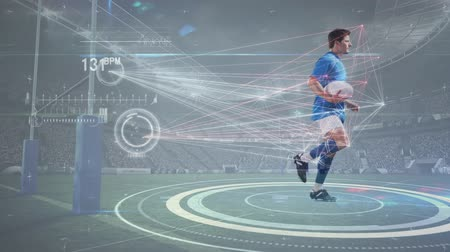 rúgbi : Digital composite of rugby player equipped with sensors to show his digital statistics running in place against professional stadium in background Vídeos