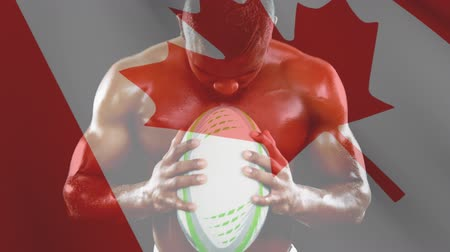 anız : Digital composite of muscled man holding an oval ball and shouting against Canadian flag waving