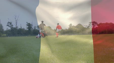 franse vlag : Digital composite of two teams of rugby players playing a game outdoors against waving French flag background