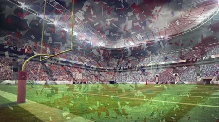 rakip : Digital composite of American football stadium with american flag and red white blue coloured coffetti raining down on foreground