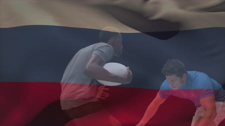 rúgbi : Digital composite of Caucasian rugby player tackling the African American player in possession of the ball against a Russian flag waving on the background
