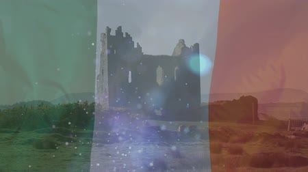 kolaps : Digital castle of a castle on the hill with Irish flag waving on the foreground and lights moving upwards Dostupné videozáznamy