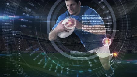 targeted : Digital composite of a handsome Caucasian male rugby player diving to score in a stadium while being targeted by a digital viewfinder animated on the foreground