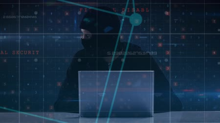 intruder : Digital composite of hacker wearing balaclava using computer with computer terms displayed on the background Stock Footage