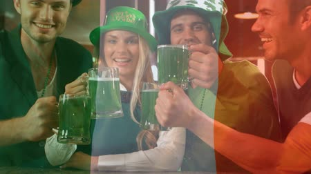 patrik : Digital composite of young diverse people holding green beer and toasting for the St Patricks Day with Irish flag waving on the foreground